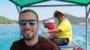 Josh and the friendly long-boat captain. Koh Tao, Thailand.
