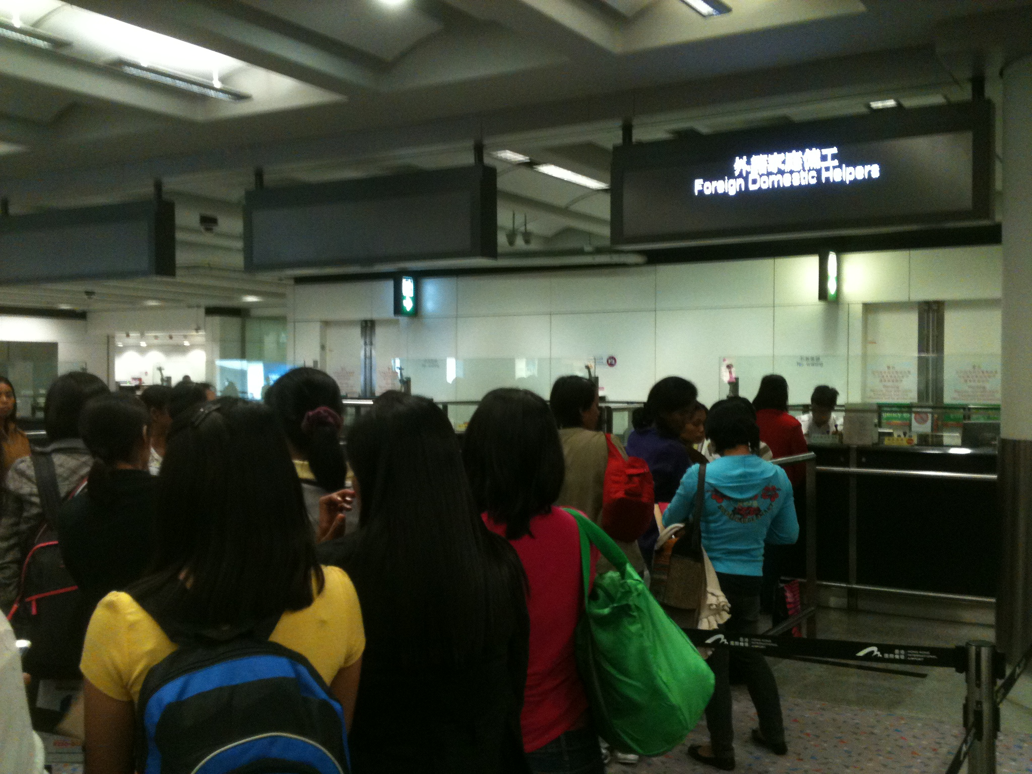"Taken at Hong Kong airport immigration, the sign identifies a lane only for ""domestic helpers."""